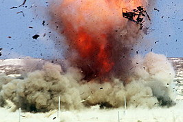 An explosion scatters debris during a live-fire demonstration