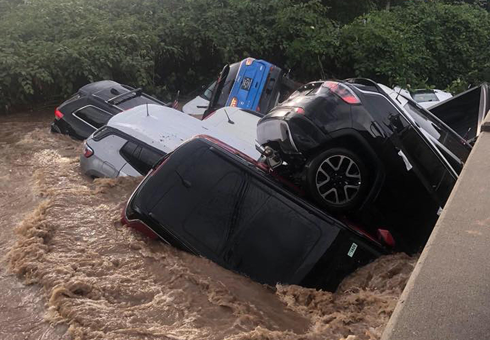 flood washes away cars — why is mayor blaming dealership?