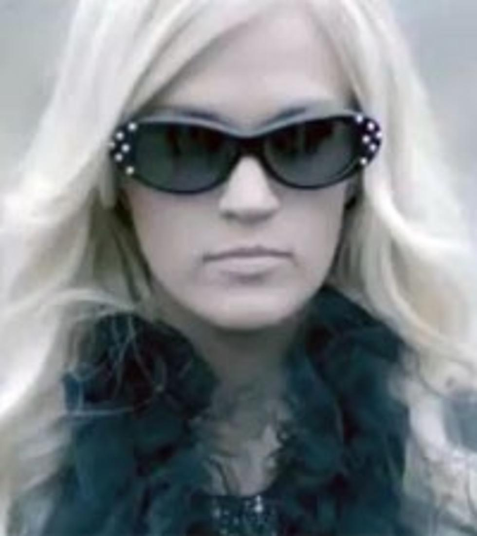 """Carrie underwood """"two black cadillacs"""" sheet music in f minor."""