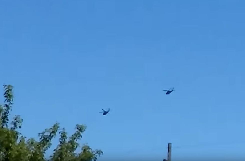 black helicopters in the sky