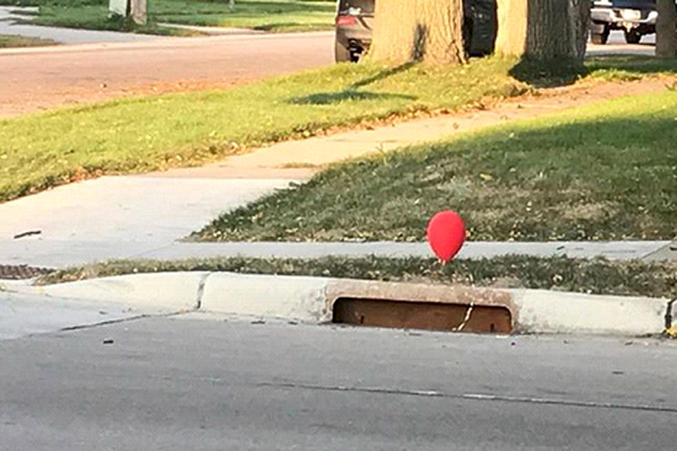 these red balloons tied to a sewer grate have a creepy meaning