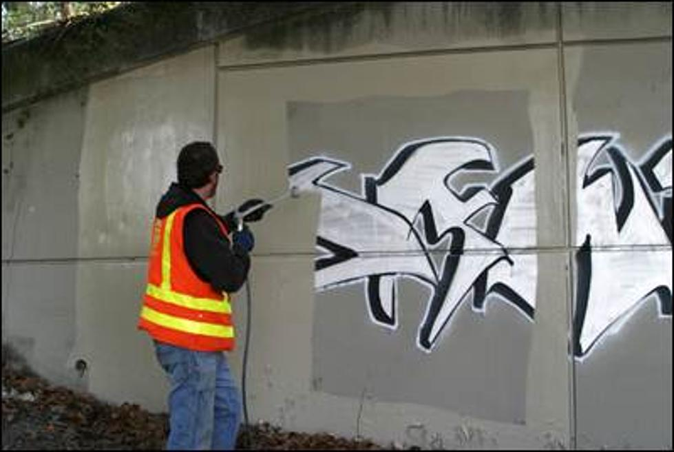 How do you clean graffiti from a cedar picket fence?