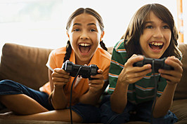 Girl and boy playing video game