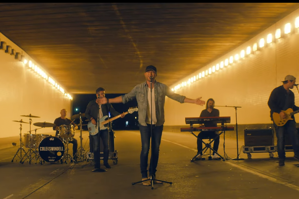 Cole Swindell Brings The Action In Love You Too Late Video
