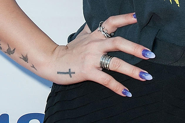 c93c499e7 Demi Lovato vs. Harry Styles: Whose Hand Tattoo Is Best?