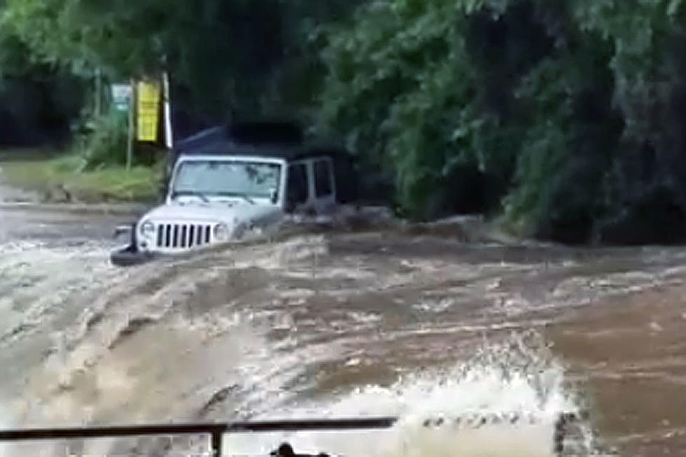 Nasty Flooding Easily Sweeps Jeep Away Along Raging River