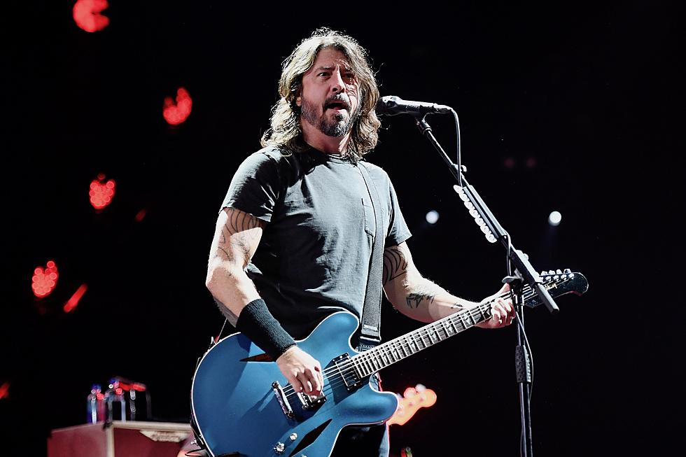 Watch Dave Grohl Shotgun Beer Onstage With a Fan at Festival