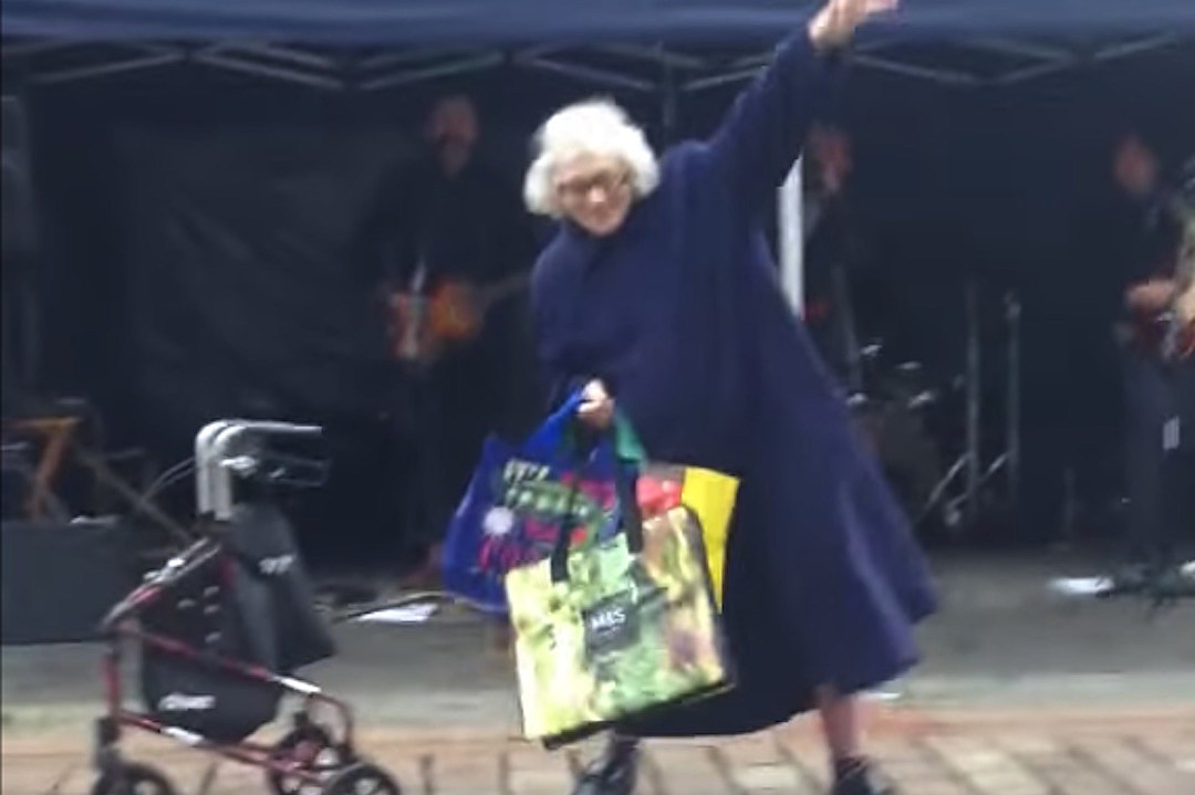 Elderly Woman Hears AC/DC Song, Stops to Dance + Wows Crowd