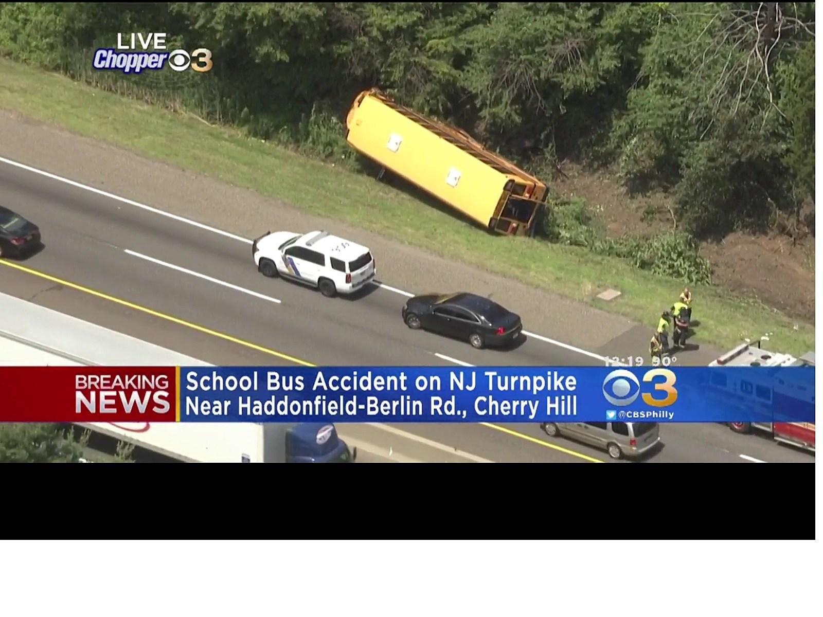 School bus flips on its side along NJ Turnpike in South Jersey