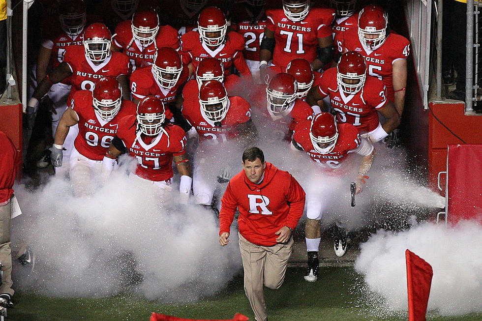 The football team  running out to the field before a game