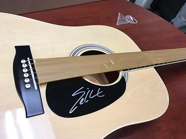 See the Autographed Guitars You Can Bid on for Our Veterans