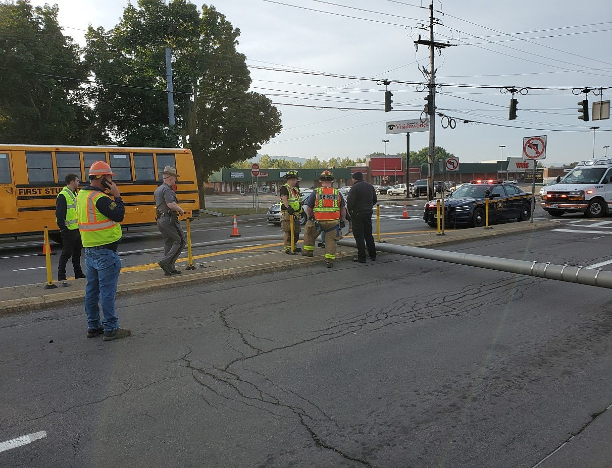 Utility Pole Knocked Down, Strikes Vehicle on Front Street
