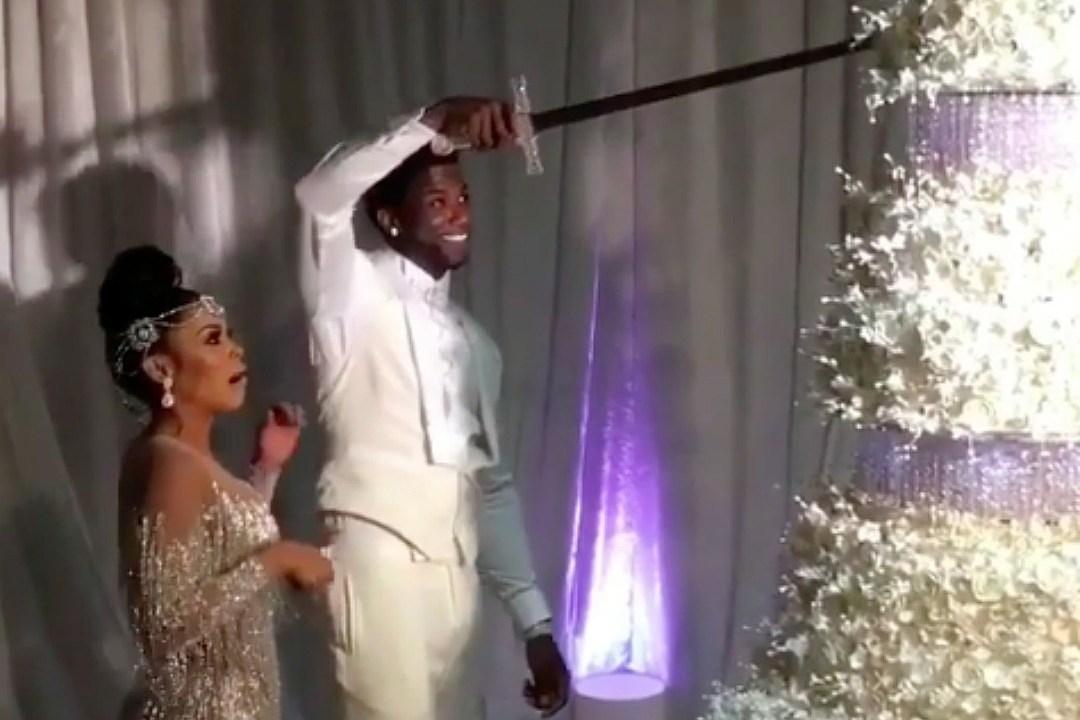 Watch Gucci Mane Cut His $75,000 Wedding Cake With a Sword , XXL