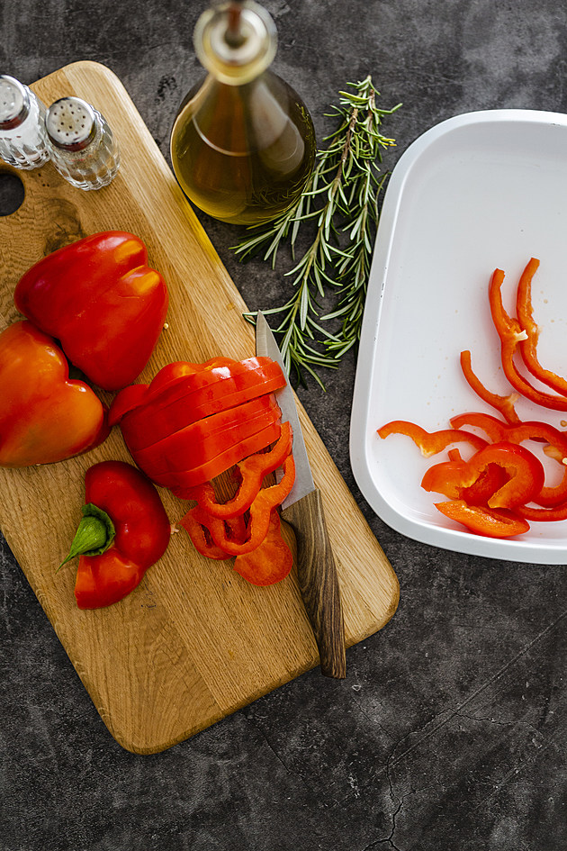 Red bell pepper on chopping board, chopping